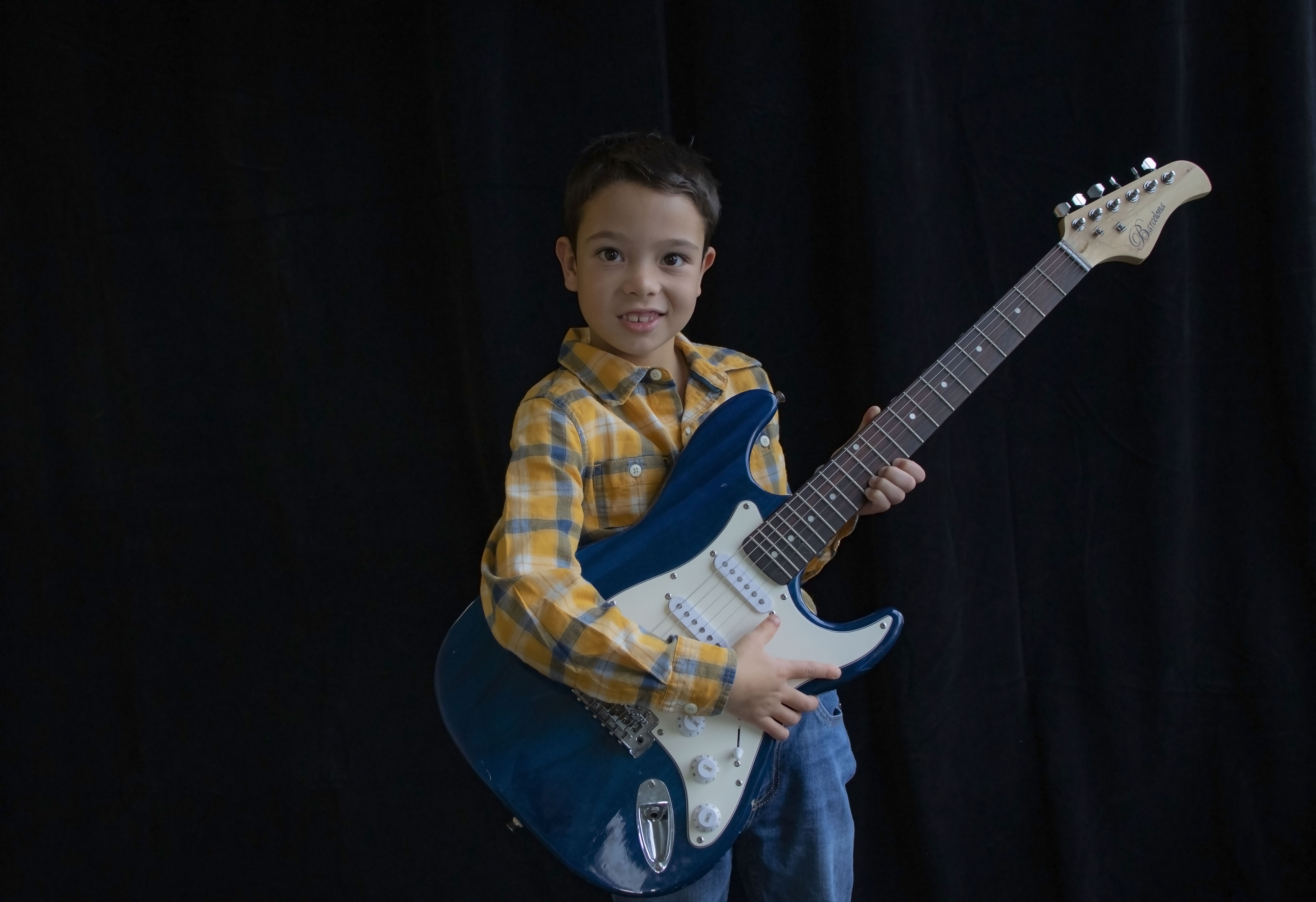 electric guitar lessons houston boy